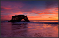 A dramatic sunset turned skies pink and orange over the natural bridges